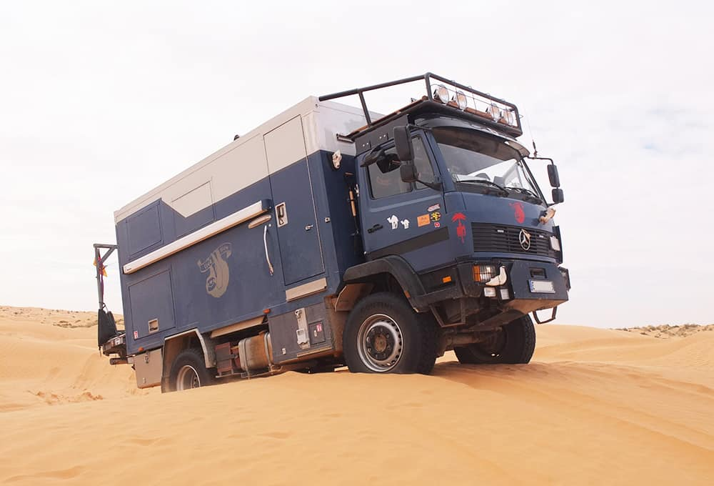 Expedition vehicle with heavy duty shock absorbers