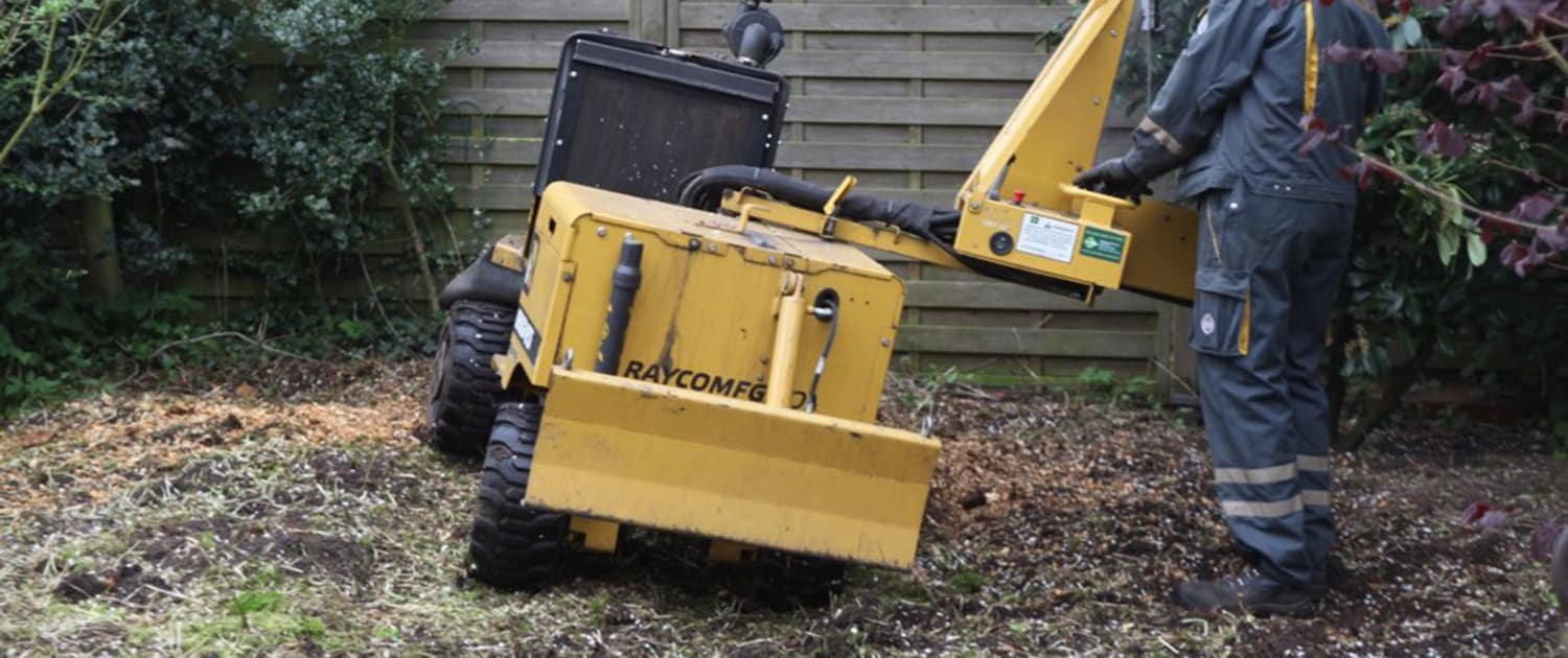 Reinforced shock absorbers for machines in landscape maintenance