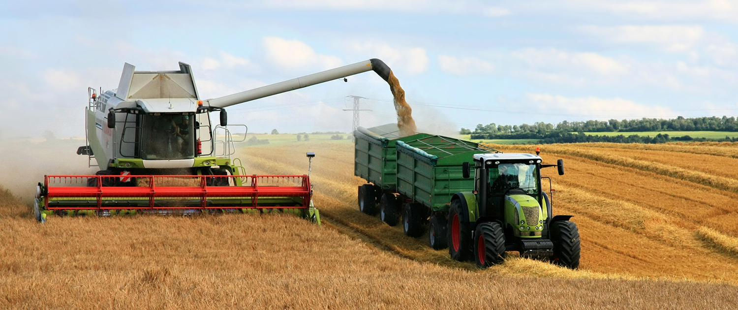 Reinforced shock absorbers for combine harvesters and tractors